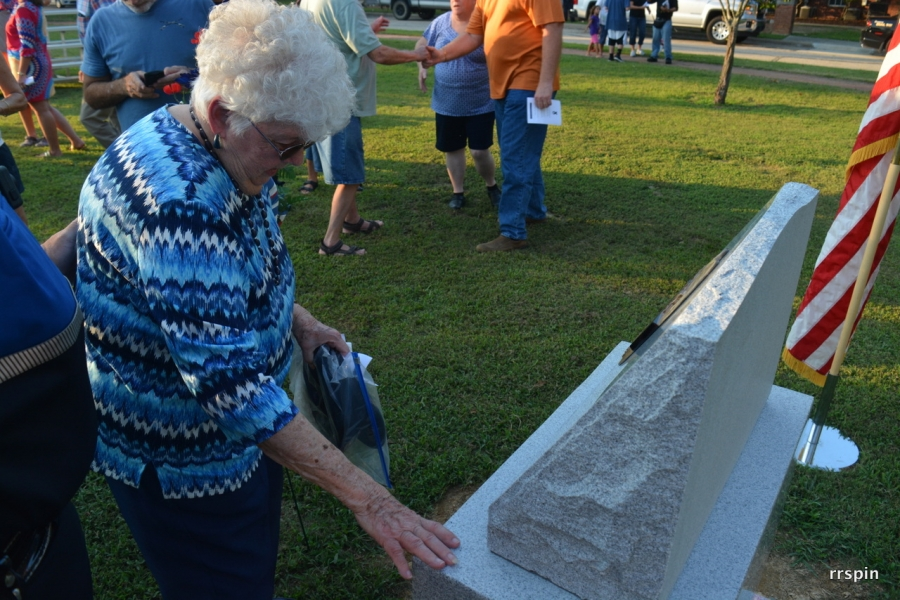 Burnette places her hand on the memorial following the ceremony.