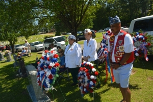 Veterans stand by with wreathes to be laid at the foot of the veterans memorial at Cedarwood today.