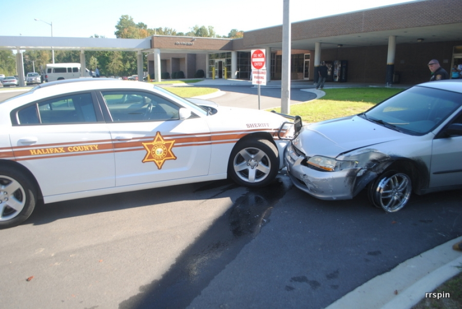 Phillips' patrol car was involved in the crash with Sykes' vehicle.