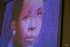 Projection of a portrait of Baker from a video played to commissioners today.