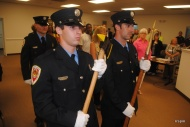 Members of the fire department's color guard stand at attention.