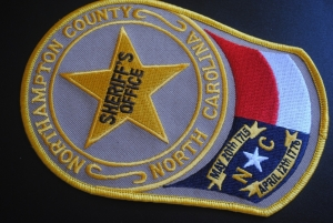 One on the lam, one charged in NCSO traffic stop