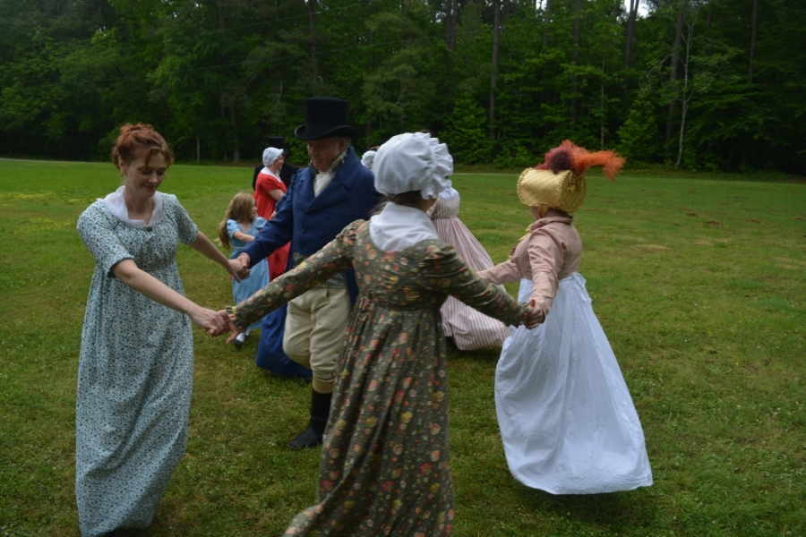 A period dance is demonstrated on the front lawn of Sally-Billy House.