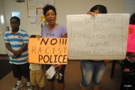 Supporters of Gorham held posters during the meeting.