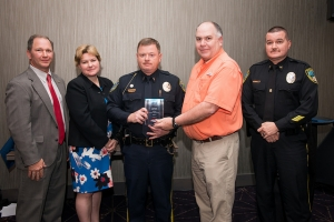 Davis, holding plaque, is pictured with, from left, Don Nail, head of the Governor's Highway Safety Program; Meg Miller, traffic safety specialist for Region 3 of the National Highway Traffic Safety Association; Bob Stevens of the GHSP; and Tarboro police Chief Jesse Webb.