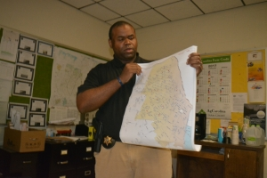 Scott shows officers a map of the county where sex offenders are located.