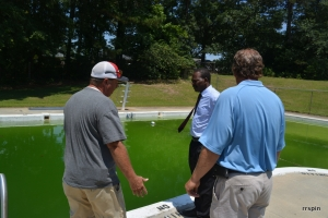 Ferebee, center, and Simeon, right, discuss the pool with Mike Manning of the parks department.