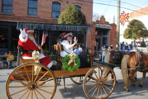 Santa is carried down King Street during last year's parade.