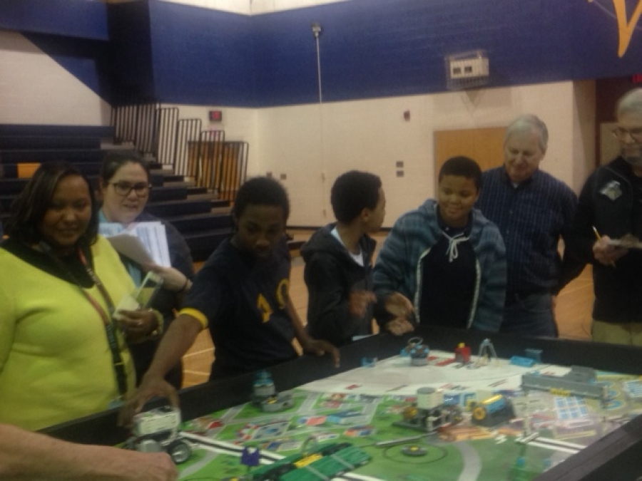 From left, William R. Davie Middle and Everetts Elementary STEM instructor Daria Johnson, Davie Robotics assistant coach and Exceptional Children instructor Cameron Foster, and students Claude Solomon, Artez Johnson, and Semaj Pierce look on during last week's scrimmage.