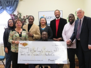 Members of the school board pose with the promotional check and representatives from GCF.