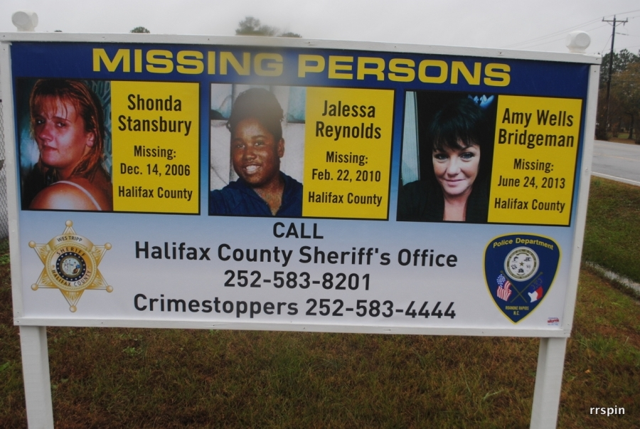 Reynolds photo is featured on a sign seeking information on the missing in Halifax County.