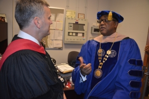 Stein, left, talks with HCC President Michael Elam before commencement exercises.