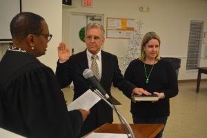 Hinton administers the oath office to Doughtie as his daughter Lauren holds the Bible.