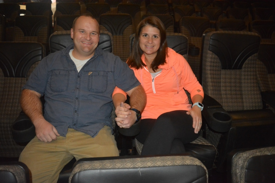 Blaine and Janelle test out the new seats in theater 2.