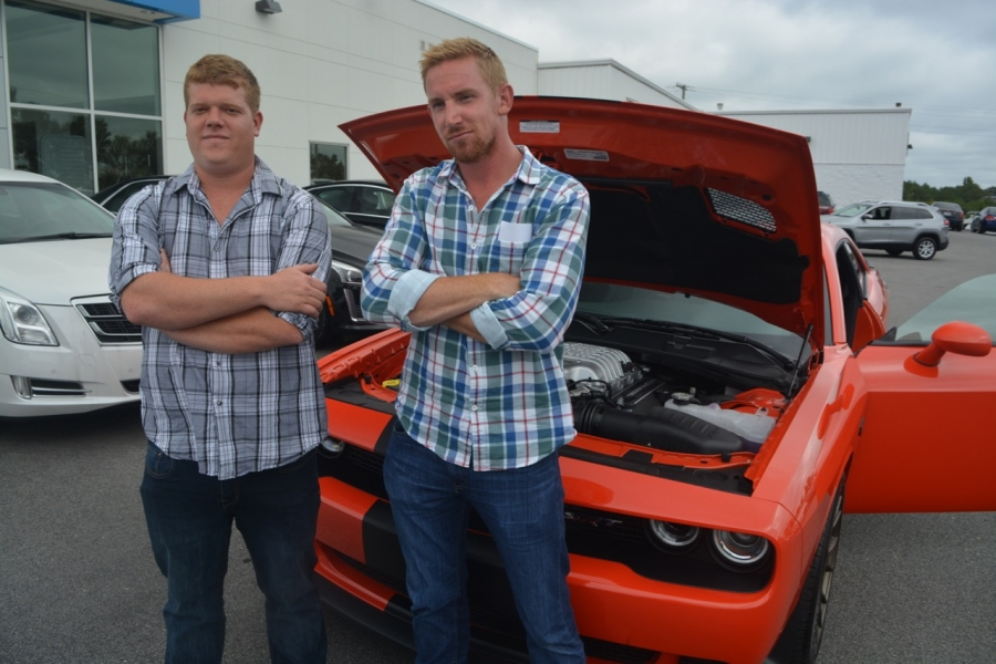 Dykstra, left, and Scheeringa pose in front of the Hellcat.