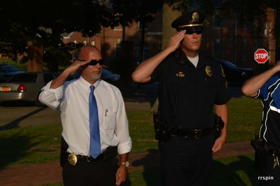 Investigator Jeff Davis and Sergeant Mike Moseley salute during the dedication of the Fallen Officers Memorial at Centennial Park in 2016.