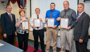 Pictured from left to right: Transportation Secretary Nick Tennyson with Extra Mile Award winners Teresa Skinner, David Griffies, Thomas Jernigan, Keith Hurdle, and Division 4 Engineer Tim Little.