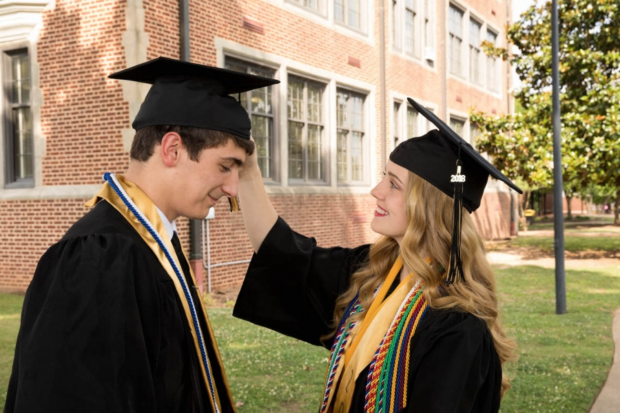 Meagan Colston adjusts the tassel on Hunter Baker's mortarboard Friday.