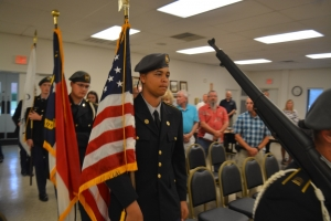 Cadets march in to post colors before the start of the meeting.