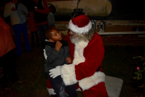 A child gives Santa his wish list.