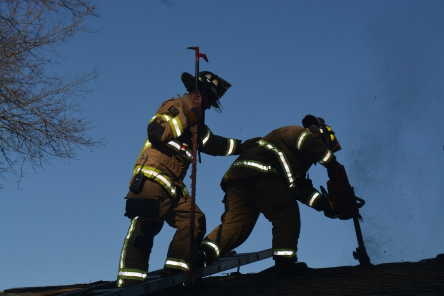 Firefighters saw into the roof of a mobile unit to practice ventilation techniques.