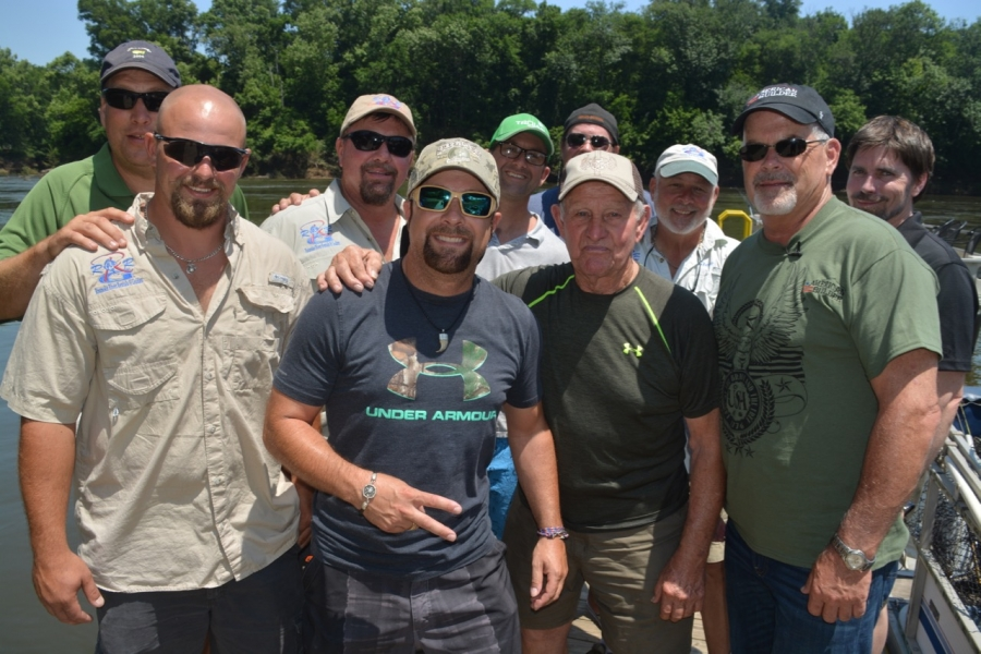 James and his father, Marion, are flanked by river guide Mike Shearin, left, Gurry. With them are Simeon, Shearin's father, Mike, and members of Gurry's crew.
