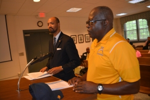 Credle, left, and Sykes, address the board.