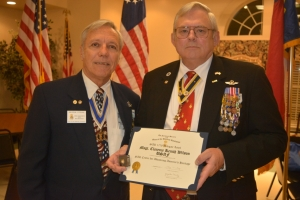 Strunk, left, honors Wilson for his service.