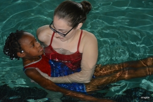 Lifeguard Holli Parks helps a student.