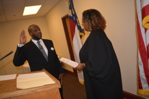 Judge Freeman administers the oath of office to her husband.
