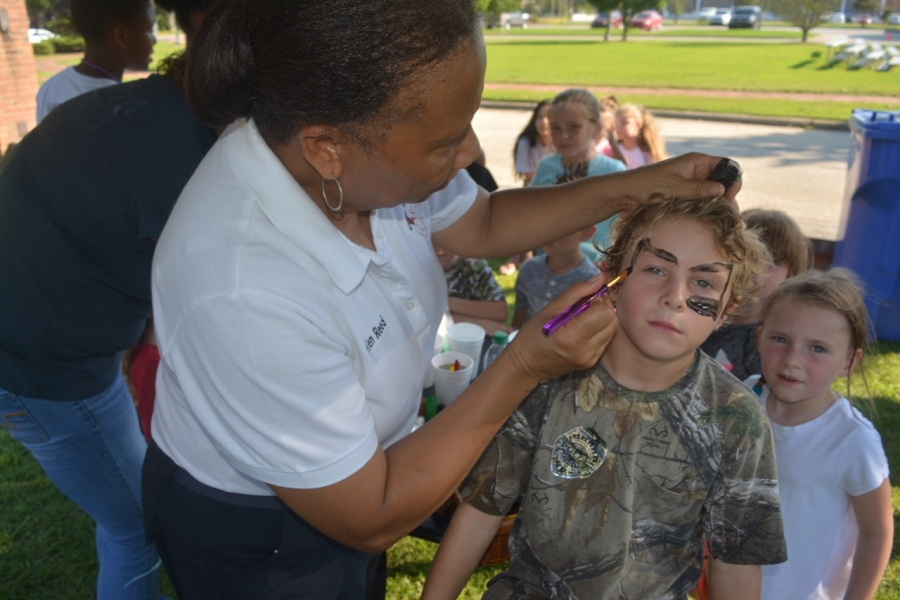 Helen Reed of the fire department paints a child's face.