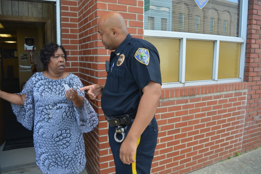 Avens talks to Administrative Assistant Cathy Adkins before going on a call Monday.