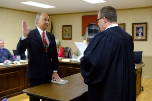 Stephenson administers the oath of office to Salanik.