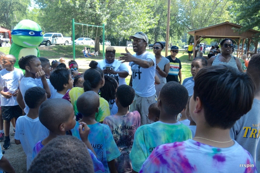 Martin talks with campers at last year's end of event celebration.