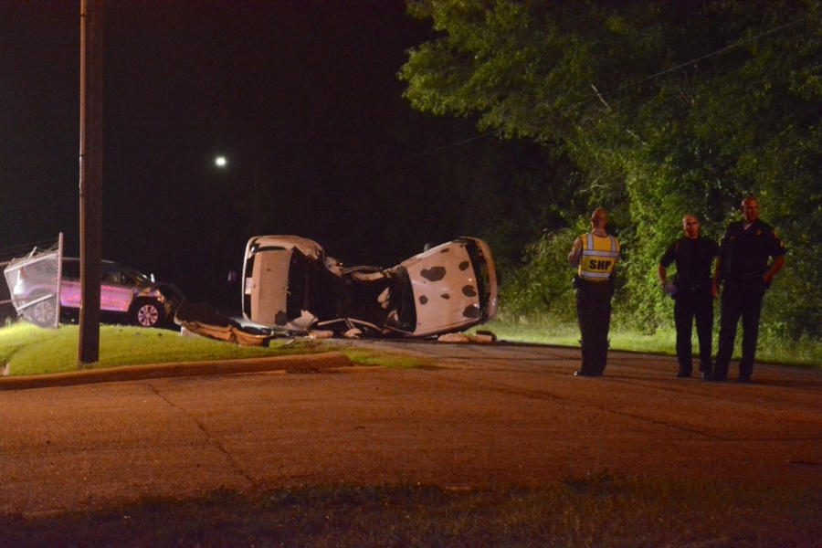 Trooper T.D. Forsht takes a photo of the crash site Saturday evening.